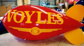 Advertising Blimps - Voyle's logo - Big balloons build business!